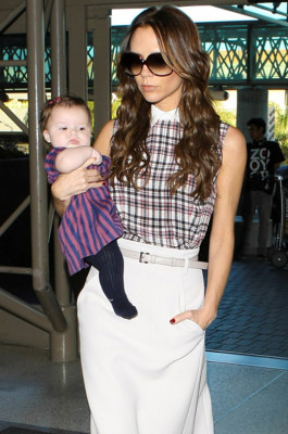 Stylish Victoria Beckham and daughter Harper cathing a flight at LAX airport in Los Angeles, CA.